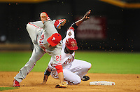 May 5, 2008; Phoenix, AZ, USA; Arizona Diamondbacks baserunner Justin Upton takes out Philadelphia Phillies second baseman (26) Chase Utley to break up a double play in the third inning at Chase Field. Mandatory Credit: Mark J. Rebilas-