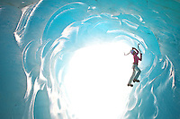 Stephanie Maureau climbing in an ice cave under the Mer de Glace glacier, France