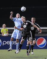 DC United defender Bryan Namoff (26) heads the ball against Colorado Rapids forward Conor Casey (9).  DC United defeated The Colorado Rapids 3-1, at RFK Stadium in Washington DC, Saturday July 18,2009.