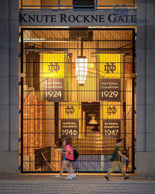 September 14, 2021; Students walk past the Knute Rockne Gate of Notre Dame Stadium. (Photo by Matt Cashore/University of Notre Dame)