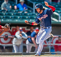 31 May 2018: New Hampshire Fisher Cats infielder Bo Bichette tries to avoid a tag at the plate in the 8th inning against the Portland Sea Dogs at Northeast Delta Dental Stadium in Manchester, NH. The Sea Dogs defeated the Fisher Cats 12-9 in extra innings. Mandatory Credit: Ed Wolfstein Photo *** RAW (NEF) Image File Available ***