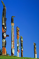 Five totem poles stand in the Klawock Totem Park on Prince of Wales Island, Alaska in the Tongass National Forest. Klawock is a Tlingit Indian village in Southeast Alaska. Klawock Alaska, Klawock Totem Park, Prince of Wales Island.