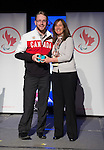 Calgary, AB - June 5 2014 - Adam Dixon receives his Paralympic ring from Erin Kelly, of Suncor/Petro-Canada, during the Celebration of Excellence Paralympic Ring Reception in Calgary. (Photo: Matthew Murnaghan/Canadian Paralympic Committee)