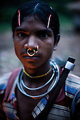 Bali Sikaka poses for a portrait in Salpojola village in Niyamgiri hills. He is one of the many people who will get displaced if the aluminium company Vedanta carries on with its plans of mining of Bauxide in Niyamgiri hills in Rayagara district of Orissa in India.