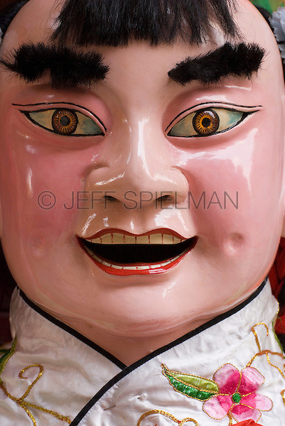 Close-up of traditonal Chinese puppet used for annual spring and autumn holiday celebrations at a Taoist temple in Chinatown, New York City, New York State, USA