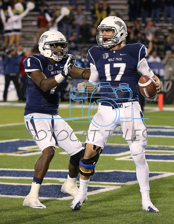 Nevada's Cody Fajardo (17) celebrates with Brandon Wimberly (1) after scoring the game-winning touchdown against Air Force during the second half of an NCAA football game in Reno, Nev., on Saturday, Sept. 28, 2013. Nevada won 45-42. (AP Photo/Cathleen Allison)