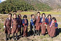 Phobjikha, Bhutan.  Kikorthang Village.  Schoolchildren Wearing Traditional Gho Outfits.