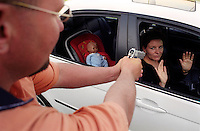 A woman attends a Hijack Prevention Course run by BMW. The participants are put through realistic senarios and are taught how to react. Here, instructor Richard Brusson enacts a gun hijack scene.
