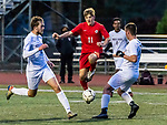 CHESHIRE, CT-111220JS15—Cheshire's Murphy Malone (11) tries to run the ball between North Haven's Justin Falasco (12) and Philip Skonieczny (17) during their SCC Division A semifinal game Thursday at Cheshire High School.<br /> Jim Shannon Republican-American
