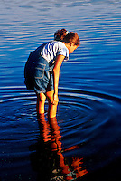 Girl exploring the shallow water, Orleans, Cape Cod