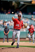 David Holman (28) of the Albuquerque Isotopes throws to first base against the Salt Lake Bees  at Smith's Ballpark on April 22, 2018 in Salt Lake City, Utah. The Bees defeated the Isotopes 11-9. (Stephen Smith/Four Seam Images)