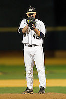Wake Forest Demon Deacons relief pitcher Nate Jones #42 looks to his catcher for the sign against the Florida State Seminoles at Wake Forest Baseball Park on March 24, 2012 in Winston-Salem, North Carolina.  The Seminoles defeated the Demon Deacons 3-2.  (Brian Westerholt/Four Seam Images)
