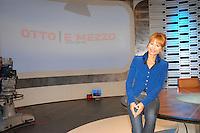 "LILLI GRUBER .Press conference for the new transmission of LA7 ""Otto e mezzo condotta"" with Lilli Gruber and Federico Guiglia, Rome, Italy, September 2008..half length suit jacket blue sitting on table jeans .CAP/CAV.©Luca Cavallari/Capital Pictures"