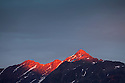 Red light bathing mountain peaks at sunset, Nordtirol, Tirol, Austrian Alps, Austria, July.