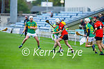 Ballyheigue's Jordan Goggin about to hand pass the ball out of danger as  Lixnaw's James Flaherty challenges him in Round 2 of the County Senior Hurling championship,