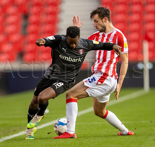 31st October 2020; Bet365 Stadium, Stoke, Staffordshire, England; English Football League Championship Football, Stoke City versus Rotherham United; Florian Jozefzoon of Rotherham United is tackled by Morgan Fox of Stoke City