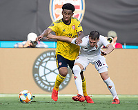 CHARLOTTE, NC - JULY 20: Reiss Nelson #24 and Sebastian Cristoforo #18 go for the ball during a game between ACF Fiorentina and Arsenal at Bank of America Stadium on July 20, 2019 in Charlotte, North Carolina.