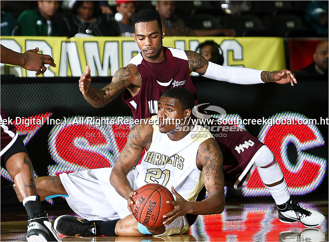 Alabama A&M Bulldogs guard Cornelius Hester (11) and Alabama State Hornets guard Tramaine Butler (21) in action during the SWAC Tournament game between the Alabama State Hornets and the  Alabama A&M Bulldogs at the Special Events Center in Garland, Texas. Alabama State Hornets defeat Alabama A&M Bulldogs 81 to 61