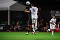 LAKE BUENA VISTA, FL - JULY 23: Daniel Steres #5 of the LA Galaxy heads the ball during a game between Los Angeles Galaxy and Houston Dynamo at ESPN Wide World of Sports on July 23, 2020 in Lake Buena Vista, Florida.