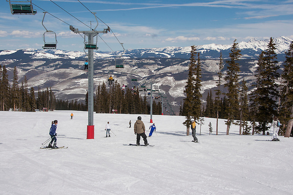 Skiers and snowboarders at Beaver Creek Ski Area, Colorado, .  John leads private ski trips to Front Range and Summit County Ski Areas in Colorado.