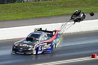 Jun. 16, 2012; Bristol, TN, USA: NHRA funny car driver Tony Pedregon during qualifying for the Thunder Valley Nationals at Bristol Dragway. Mandatory Credit: Mark J. Rebilas-