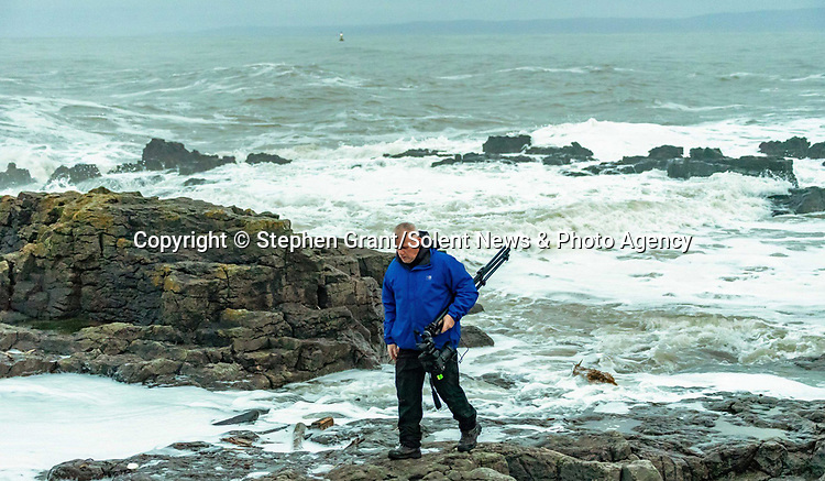 """Pictured:  Stephen Grant<br /> <br /> A sea horse, wolf and lion appeared in blasts of spray as huge waves crash against a pier.  As the storm raged, giant walls of water battered the coastline and erupted in clouds above the pier, forming shapes of animals in the mist.<br /> <br /> Stephen Grant, 60, who lives in Porthcawl, Wales, with his wife Kath, caught all the images on the same morning in the seaside town.  He said: """"Storms occur throughout the year especially when the winds are blowing south-south westerly with gusts reaching up to 30mph to 40mph that cause big swells, throwing the waves over the pier, peaking at times to 20ft to 30ft high.  SEE OUR COPY FOR DETAILS.<br /> <br /> Please byline: Stephen Grant/Solent News<br /> <br /> © Stephen Grant/Solent News & Photo Agency<br /> UK +44 (0) 2380 458800"""