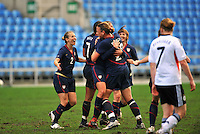 The USA celebrates a goal by Carli Lloyd.  .The USA captured the 2010 Algarve Cup title by defeating Germany 3-2, at Estadio Algarve on March 3, 2010.