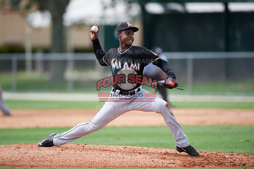 GCL Marlins starting pitcher Miguel De Los Santos (13) delivers a pitch during a game against the GCL Astros on July 22, 2017 at Roger Dean Stadium Complex in Jupiter, Florida.  GCL Astros defeated the GCL Marlins 5-1, the game was called in the seventh inning due to rain.  (Mike Janes/Four Seam Images)
