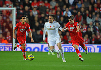 Saturday 10 November 2012<br /> Pictured: Michu of Swansea (C) is challenged by Morgan Schneiderlin (R) of Southampton<br /> Re: Barclay's Premier League, Southampton FC v Swansea City FC at St Mary's Stadium, Southampton, UK.