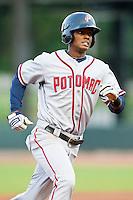 Michael Taylor #12 of the Potomac Nationals hustles towards third base against the Winston-Salem Dash at BB&T Ballpark on April 23, 2012 in Winston-Salem, North Carolina.  (Brian Westerholt/Four Seam Images)
