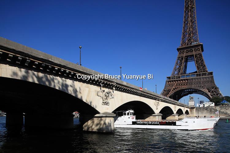 A tour boat under Pont d'Iéna Iena bridge with Eiffel Tower La tour eiffel in the background. City of Paris. Paris. France