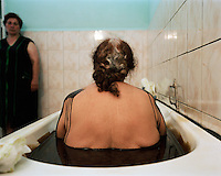 Mirzoyeva Raxita, patient at the Shafa Sanatorium. Each session, patients bathe for ten minutes in a tub of crude oil. The oil is heated to 37 degrees for optimum effectiveness.