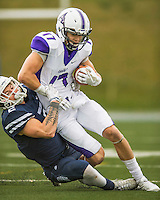 8 October 2016: Amherst College Purple & White Wide Receiver Nick Widen, a Senior from Weston, MA, is tackled by Middlebury College Panther Defensive Back Nate Leedy, a Senior from Naples, FL at Alumni Stadium in Middlebury, Vermont. The Panthers edged out the Purple & While 27-26. Mandatory Credit: Ed Wolfstein Photo *** RAW (NEF) Image File Available ***