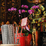 Bao-jhong Yi-min Temple, Kaohsiung -- 'Qian' sticks in front of a temple god statue.<br /> <br /> The Taoist believer asks the gods a question in prayer, then shakes the urn with the sticks inside until one of them sticks out higher than the others. This is the 'qian' that gives him the answer of the gods.<br /> <br /> He shows the 'qian' to a  monk at the temple who will fetch a corresponding piece of paper with an ancient text on it from a cabinet. The monk proceeds to explain the writing on the paper and interprets its meaning and the gods' answers.