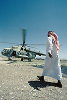 Emissary from a Arab country bringing help (Us dollars) to warlord Mohammad Ismael Khan..The helicopter fly from Shindand Airport to the frontline with the Taliban south of the Farah city..Mohammad Ismael Khan is the Minister of Energy and Water in Hamid Karzai's government. Before joining Karzai's cabinet, Ismael Khan served as the governor of Herat province.