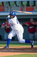 Yunior Figueroa #24 of the Burlington Royals follows through on his swing against the Kernersville Bulldogs in an exhibition game at Burlington Athletic Stadium June20, 2010, in Burlington, North Carolina.  Photo by Brian Westerholt / Four Seam Images