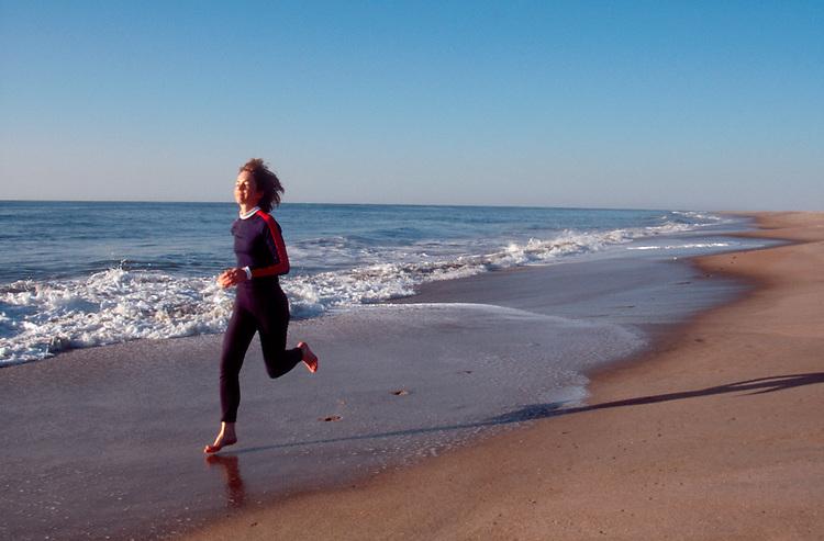Assateague Island, Woman runner, Atlantic Ocean, Maryland, model released, Maggie Coon,.