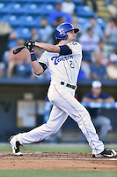 Asheville Tourists right fielder Sam Hilliard (25) swings at a pitch during a game against the Hagerstown Suns  at McCormick Field on June 7, 2016 in Asheville, North Carolina. The Tourists defeated the Suns 6-5. (Tony Farlow/Four Seam Images)
