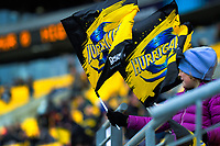 Fans wave flags during the Super Rugby Aotearoa match between the Hurricanes and Highlanders at Sky Stadium in Wellington, New Zealand on Sunday, 12 July 2020. Photo: Dave Lintott / lintottphoto.co.nz