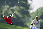 Tetsuji Hiratsuka on his second shot on the third fairway during Round 2 of the CIMB Asia Pacific Classic 2011.  Photo © Raf Sanchez / PSI for Carbon Worldwide