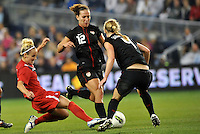 Canada forward Kelly Parker (15)  tries to get between Lauren Cheney (12) and Becky Sauerbrunn (4).