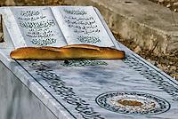 Tunis, Tunisia.  Al-Jallaz Cemetery, Bread and Seeds on Grave.