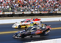 Jul. 27, 2014; Sonoma, CA, USA; NHRA funny car driver Alexis DeJoria (near lane) races alongside Cruz Pedregon during the Sonoma Nationals at Sonoma Raceway. Mandatory Credit: Mark J. Rebilas-