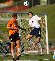 Samuel Ricketts of the Bolton Wanderers heads the ball away from the goal.  The Charlotte Eagles currently in 3rd place in the USL second division play a friendly against the Bolton Wanderers from the English Premier League.