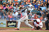 Ke'Bryan Hayes (8) of Concordia Lutheran High School in Tomball, Texas at bat in front of catcher Wyatt Cross during the Under Armour All-American Game on August 16, 2014 at Wrigley Field in Chicago, Illinois.  (Mike Janes/Four Seam Images)