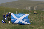 Faroe Islands 0 Scotland 2, 06/06/2007. European Championship Qualifier. Two Scottish fans putting up flags behind the goals before the Euro 2008 group B qualifying match at the Svangaskard stadium in Toftir between the Faroe Islands and Scotland. The visitors won the match by 2 goals to nil to stay in contention for a place at the European football championships which were to be held in Switzerland and Austria in the Summer of 2008. It was the first time Scotland had won in the Faroes, the previous two matches ended in draws. Photo by Colin McPherson.