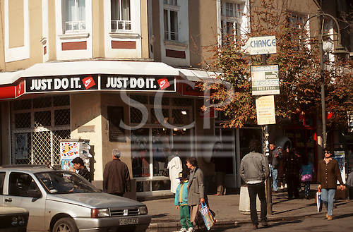 """Sofia, Bulgaria. People on the street; """"Just do it"""" sign on a NIKE shop."""