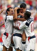 USA team celebrates, World Cup qualifier between USA and El Salvador, 2004.