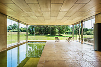 BNPS.co.uk (01202 558833)<br /> Pic: Hamptons/BNPS<br /> <br /> Pictured: The indoor swimming pool.<br /> <br /> An incredible Arts and Crafts country house with its own vineyard is on the market for offers over £7m.<br /> <br /> The Grade II listed St Joseph's Hall is a striking 111-year-old property that was home to the Bishop of Arundel for 40 years.<br /> <br /> It has a wealth of period features, an indoor swimming pool and seven acres of vineyard with mostly Chardonnay grapes, which the owners sell to a local winery.<br /> <br /> The house in Storrington, West Sussex, has 17 acres of land with beautiful views over the South Downs.