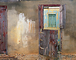 Aguilla, British West Indies<br /> Abandoned house with weathered paint and wooden doors near the Anguillan village of The Valley, Carribean islands